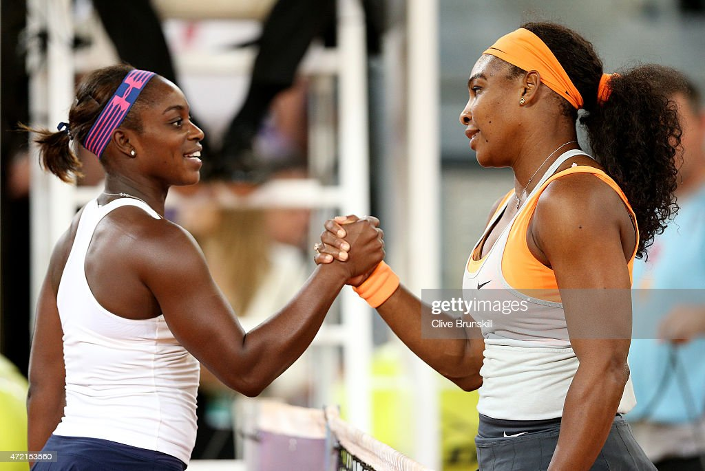 Serena Williams of United States shakes hands at the net after her straight set victory against Sloane Stephens of USA in their second round match during day three of the Mutua Madrid Open tennis tournament at the Caja Magica on May 4, 2015 in Madrid, Spain.