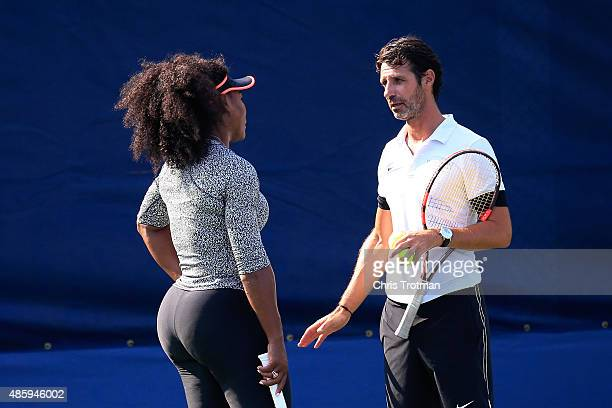 Serena Williams of United States talks with her coach Patrick Mouratoglou during a practice session prior to the US Open at USTA Billie Jean King...
