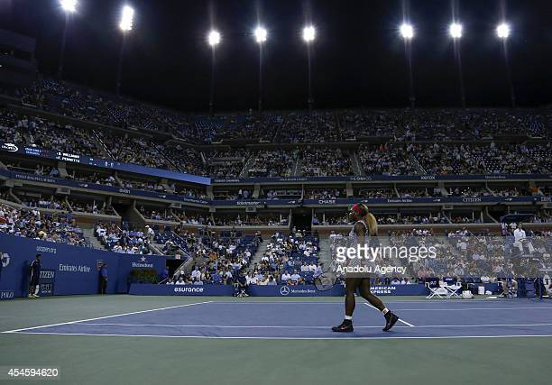 Serena Williams of United States walks along the tennis court during women's singles quarterfinal match on Day Ten of the 2014 US Open at the USTA...