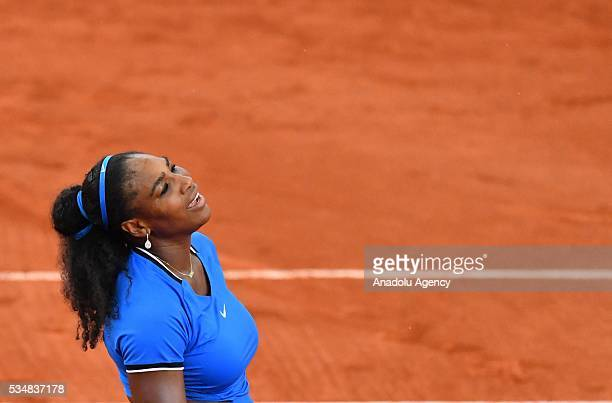 Serena Williams of US reacts during the match against Kristina Mladenovic of France during the women's single third round match at the French Open...