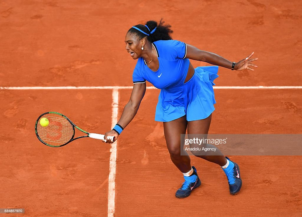 Serena Williams of US returns to Kristina Mladenovic (not seen) of France during the women's single third round match at the French Open tennis tournament at Roland Garros Stadium in Paris, France on May 28, 2016.