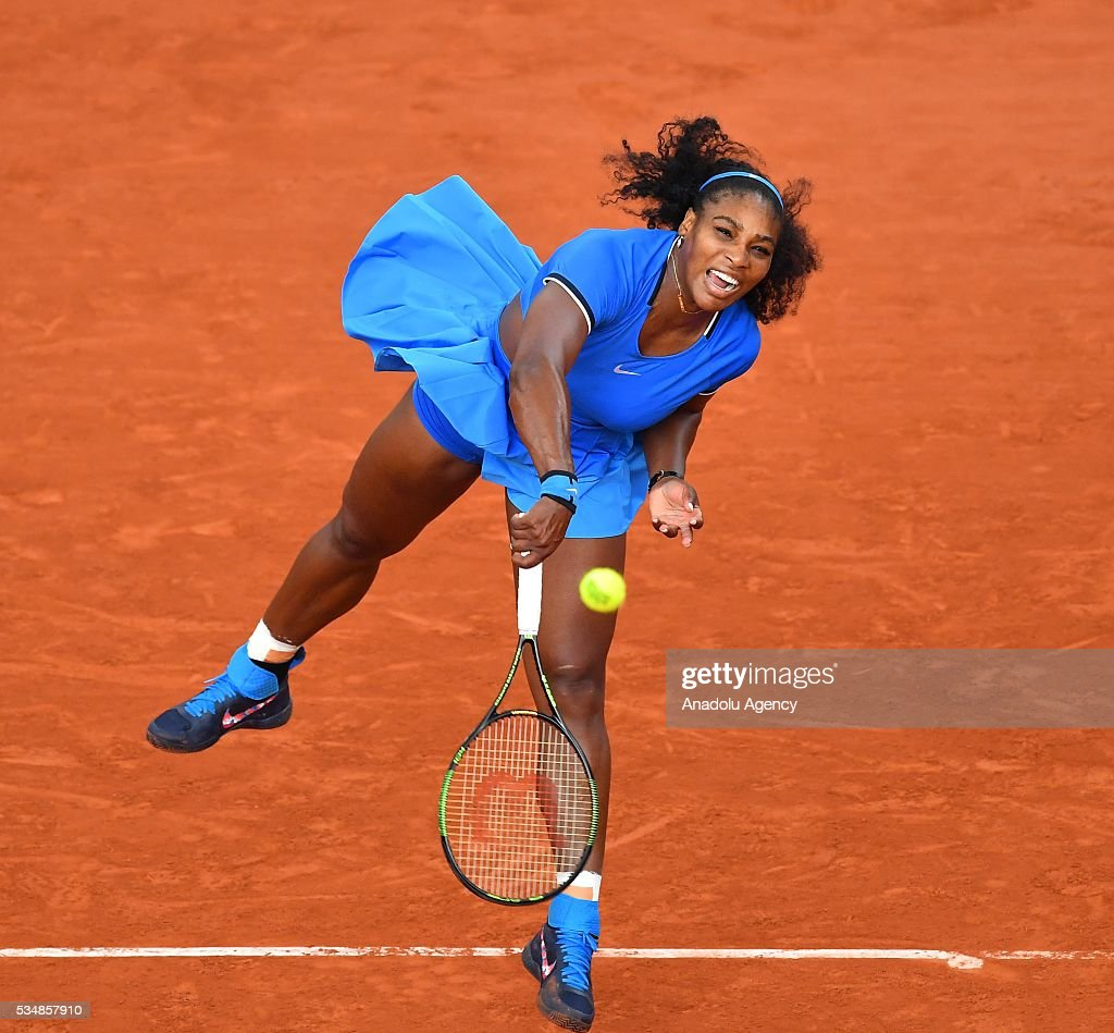 Serena Williams of US serves to Kristina Mladenovic (not seen) of France during the women's single third round match at the French Open tennis tournament at Roland Garros Stadium in Paris, France on May 28, 2016.