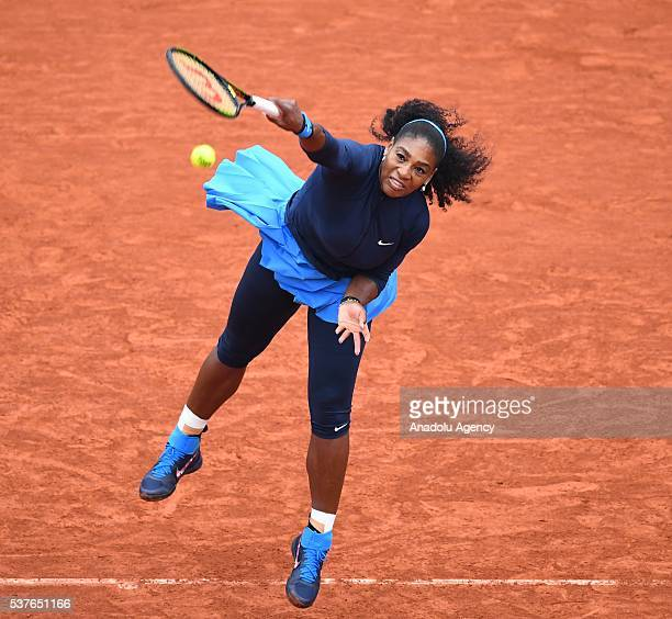 Serena Williams of US serves to Yulia Putintseva of Kazakhstan during the women's single quarter final match at the French Open tennis tournament at...