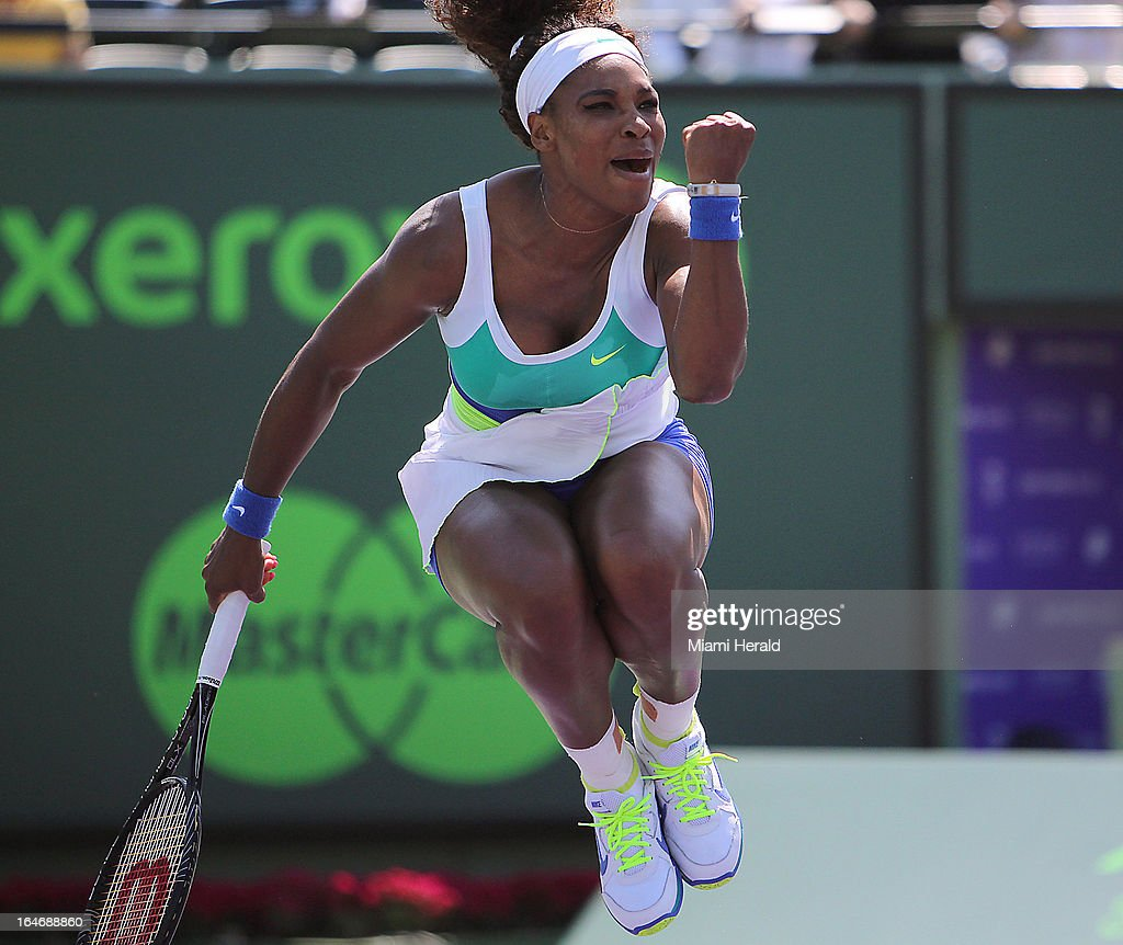 Serena Williams of USA celebrates after defeating Na Li of China 6-3, 7-6 during their match on Day 9 of the Sony Open tennis tournament at Crandon Park in Key Biscayne, Tuesday, March 26, 2013.