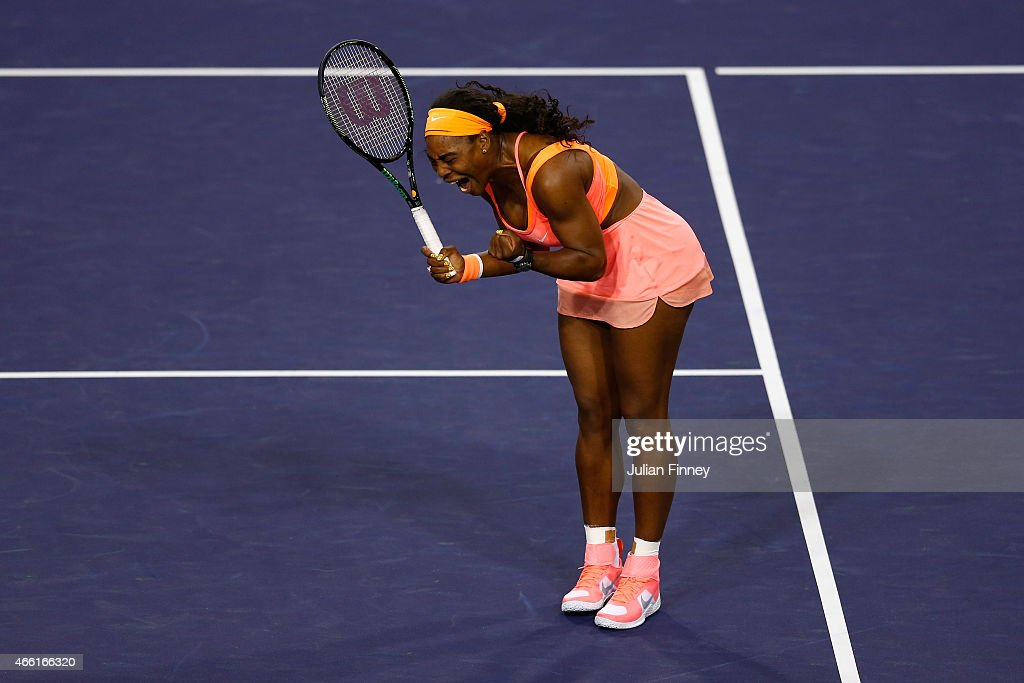 Serena Williams of USA celebrates winning a game against Monica Niculescu of Romania during day five of the BNP Paribas Open tennis at the Indian...