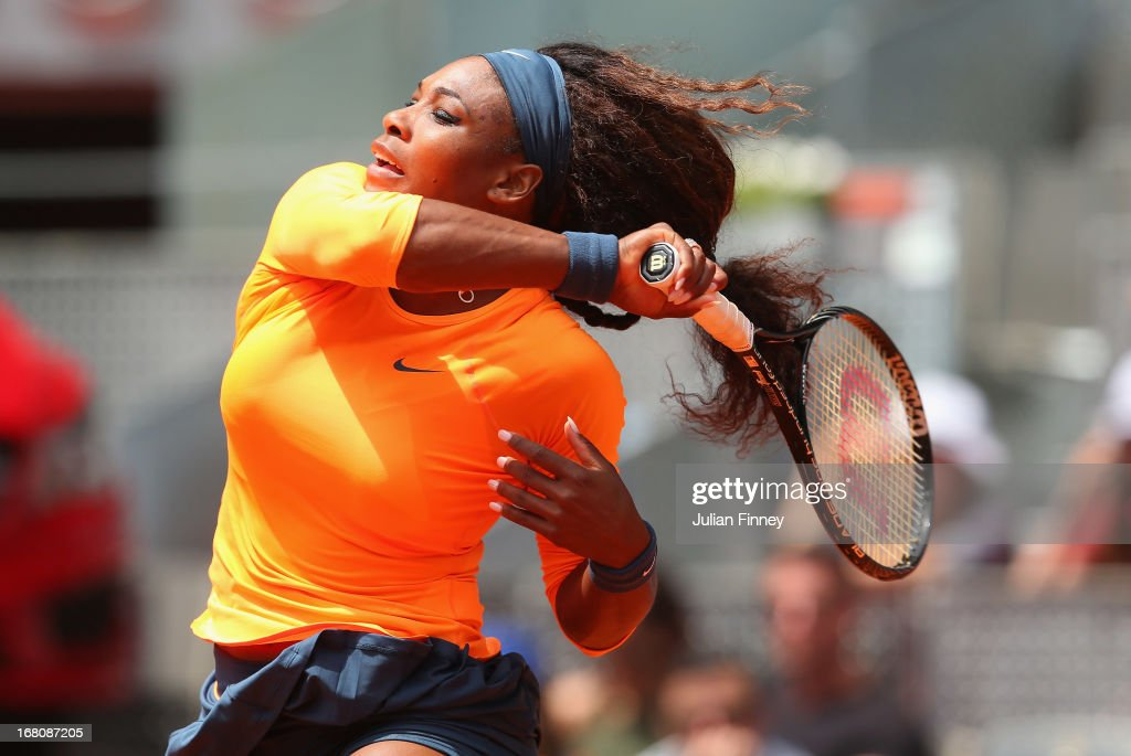 <a gi-track='captionPersonalityLinkClicked' href=/galleries/search?phrase=Serena+Williams+-+Tennis+Player&family=editorial&specificpeople=171101 ng-click='$event.stopPropagation()'>Serena Williams</a> of USA in action against Yulia Putintseva of Kazakhstan during day two of the Mutua Madrid Open tennis tournament at the Caja Magica on May 5, 2013 in Madrid, Spain.