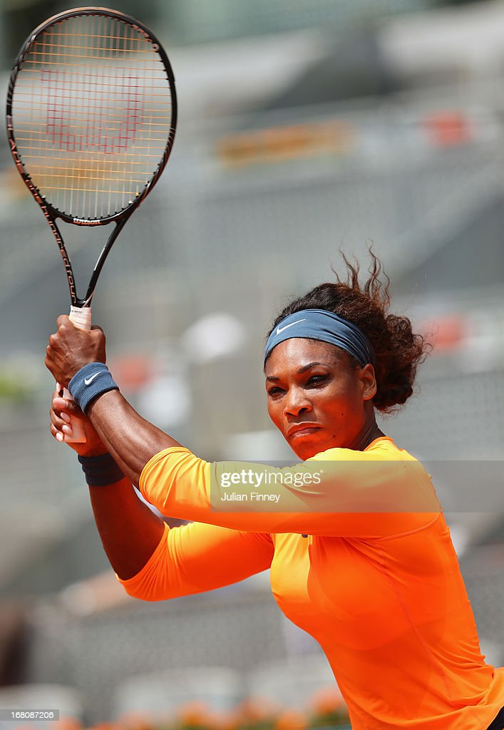 Serena Williams of USA in action against Yulia Putintseva of Kazakhstan during day two of the Mutua Madrid Open tennis tournament at the Caja Magica on May 5, 2013 in Madrid, Spain.