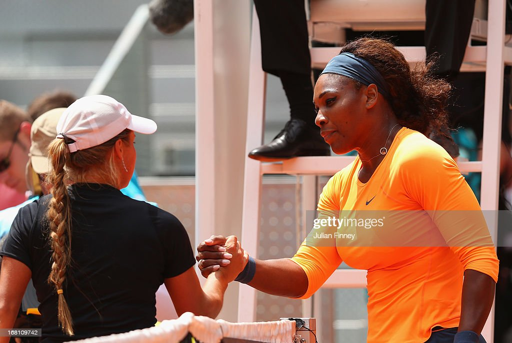 Serena Williams of USA is congratulated by Yulia Putintseva of Kazakhstan during day two of the Mutua Madrid Open tennis tournament at the Caja Magica on May 5, 2013 in Madrid, Spain.
