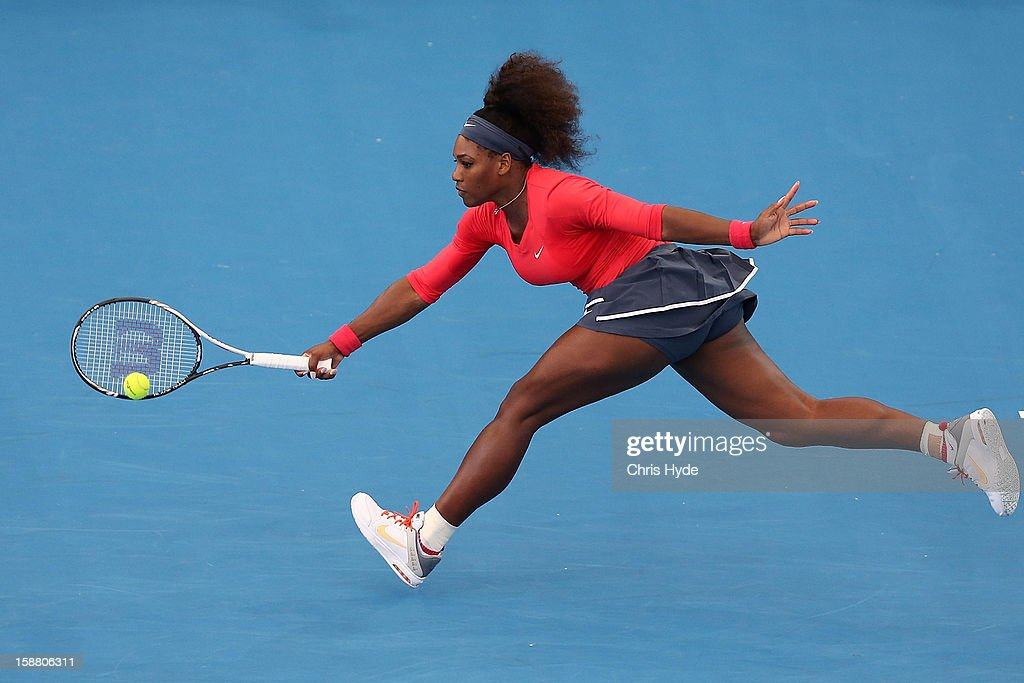<a gi-track='captionPersonalityLinkClicked' href=/galleries/search?phrase=Serena+Williams+-+Tennis+Player&family=editorial&specificpeople=171101 ng-click='$event.stopPropagation()'>Serena Williams</a> of USA plays a forehand in her match against Varvara Lepchenko of USA during day one of the Brisbane International at Pat Rafter Arena on December 30, 2012 in Brisbane, Australia.