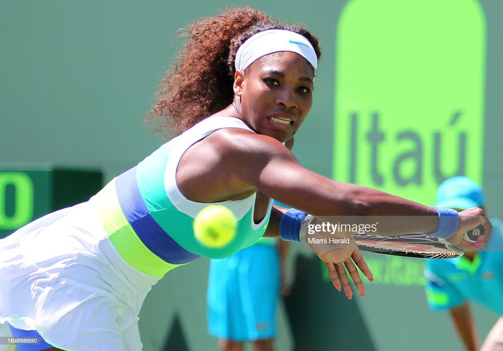 Serena Williams of USA returns the ball to Na Li of China during their match on Day 9 of the Sony Open tennis tournament at Crandon Park in Key Biscayne, Tuesday, March 26, 2013.