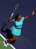 Serena Williams of USA serves to Victoria Azarenka of Belarus in the final during day fourteen of the BNP Paribas Open at Indian Wells Tennis Garden...