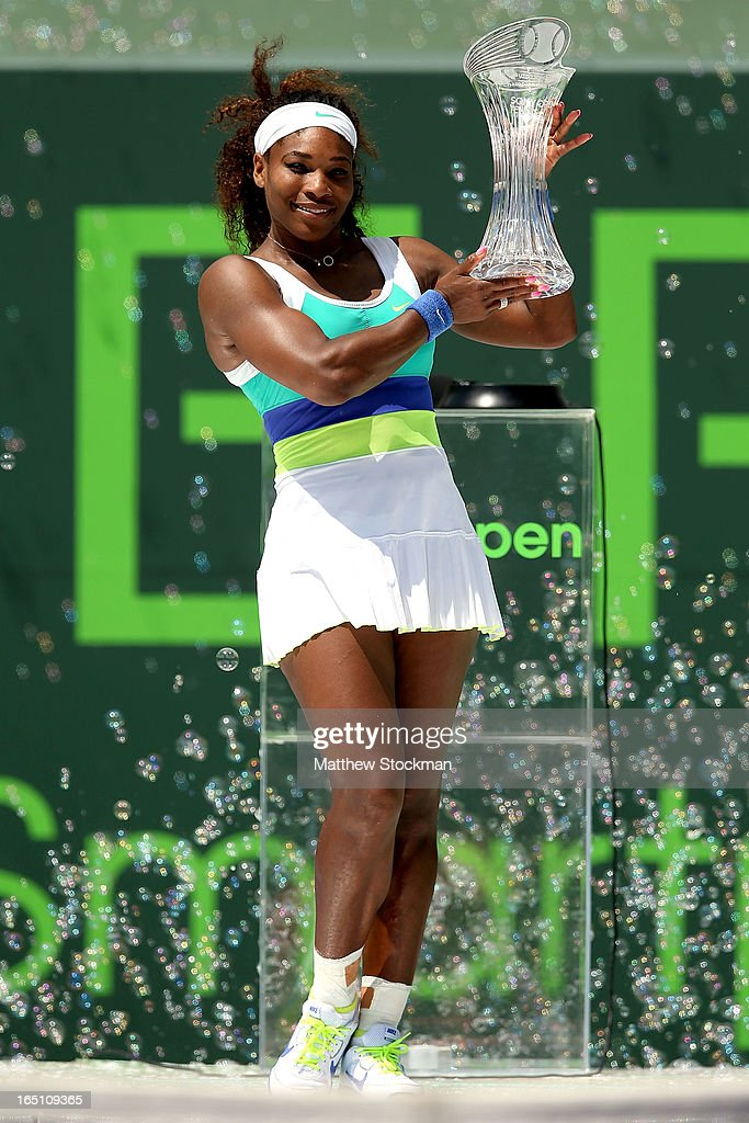 Serena Williams poses for photographers with the winners trophy after defeating Maria Sharapova of Russia during the final of the Sony Open at Crandon Park Tennis Center on March 30, 2013 in Key Biscayne, Florida.