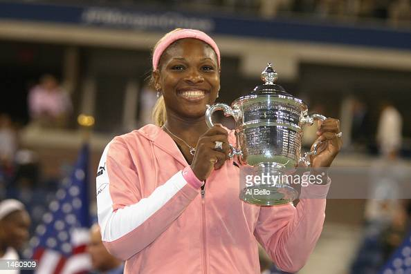 Serena Williams poses with her winning trophy after the finals at the US Open September 7 2002 at the USTA National Tennis Center in Flushing Meadows...