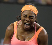 Serena Williams reacts after winning her first game in the first set against Monica Niculescu of Romania during the BNP Parisbas Open at the Indian...