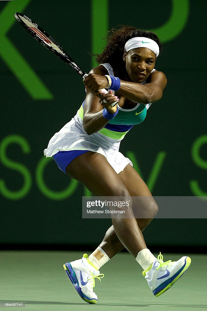 Serena Williams returns a shot to Ayumi Morita of Japan during the Sony Open at Crandon Park Tennis Center on March 23, 2013 in Key Biscayne, Florida.