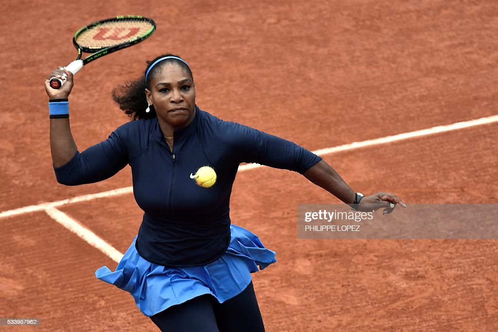 US Serena Williams returns the ball to Slovakia's Magdalena Rybarikova during their women's first round match at the Roland Garros 2016 French Tennis Open in Paris on May 24, 2016. / AFP / PHILIPPE