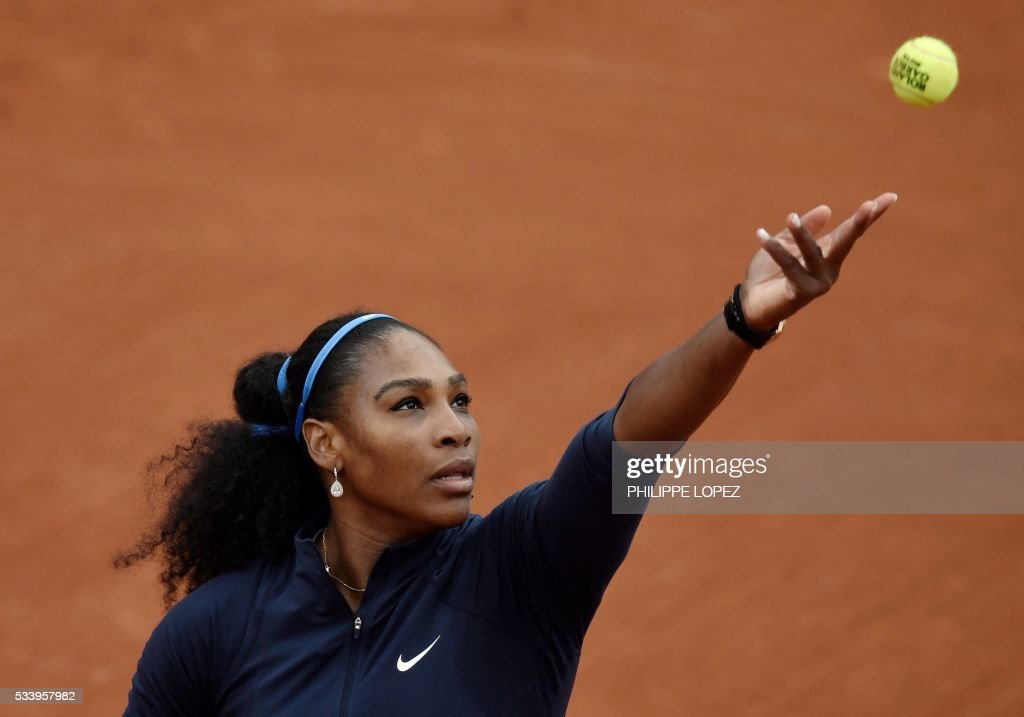 US Serena Williams serves the ball to Slovakia's Magdalena Rybarikova during their women's first round match at the Roland Garros 2016 French Tennis Open in Paris on May 24, 2016. / AFP / PHILIPPE