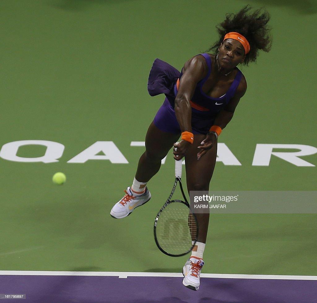 US Serena Williams serves to Russia's Maria Sharapova during their WTA Qatar Open semi-final tennis match on February 16, 2013 in the Qatari capital, Doha. Williams won 6-3,6-2. AFP PHOTO / AL-WATAN DOHA / KARIM JAAFAR == QATAR OUT ==