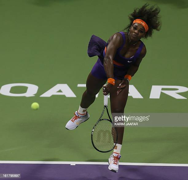 US Serena Williams serves to Russia's Maria Sharapova during their WTA Qatar Open semifinal tennis match on February 16 2013 in the Qatari capital...