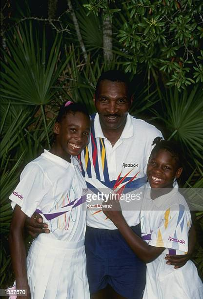 Serena Williams stands with her sister Venus Williams and father Richard Williams at a tennis camp in Florida Mandatory Credit Ken Levine /Allsport