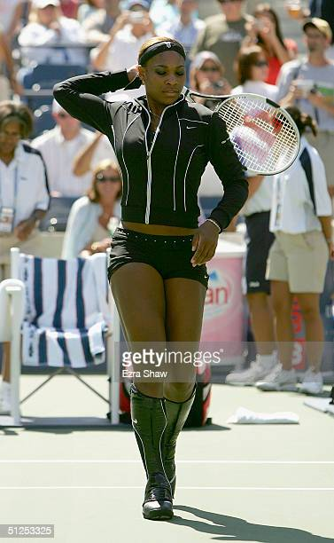 Serena Williams takes the court for a warm up prior to her match against Lindsay LeeWaters during the US Open September 1 2004 at the USTA National...