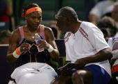 Serena Williams talks with her father Richard Williams after the first set against Nicole Vaidisova of the Czech Republic during their quarterfinals...
