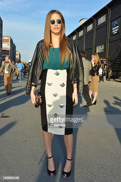 Serenay Sarikaya wearing Tuvana dress and Atil Kutogli shoes is seen during MercedesBenz Fashion Week Istanbul Fall/Winter 2013/14 at Antrepo 3 on...