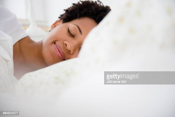Serene Black woman laying in bed