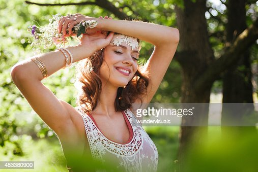 Serene boho girl looking relaxed in a summer park