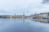 Serene cityscape landscape scene. Long exposure, blurry sea/river/lake water. Hamburg,  Germany.