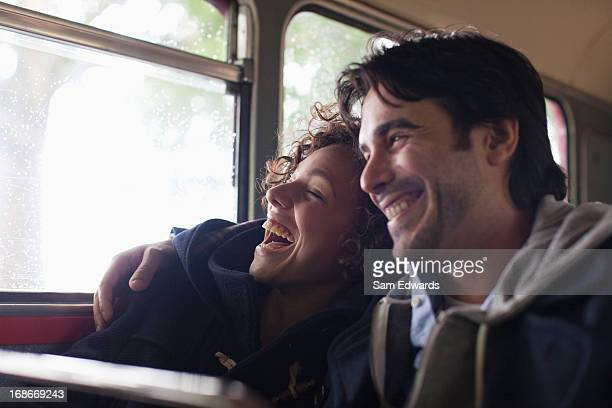 Serene couple hugging on bus
