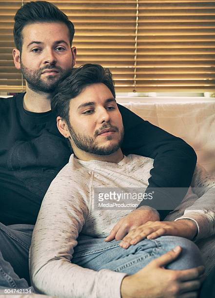 Serene gay couple at home