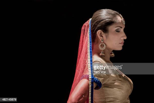 Serene Indian bride with eyes closed in traditional clothing