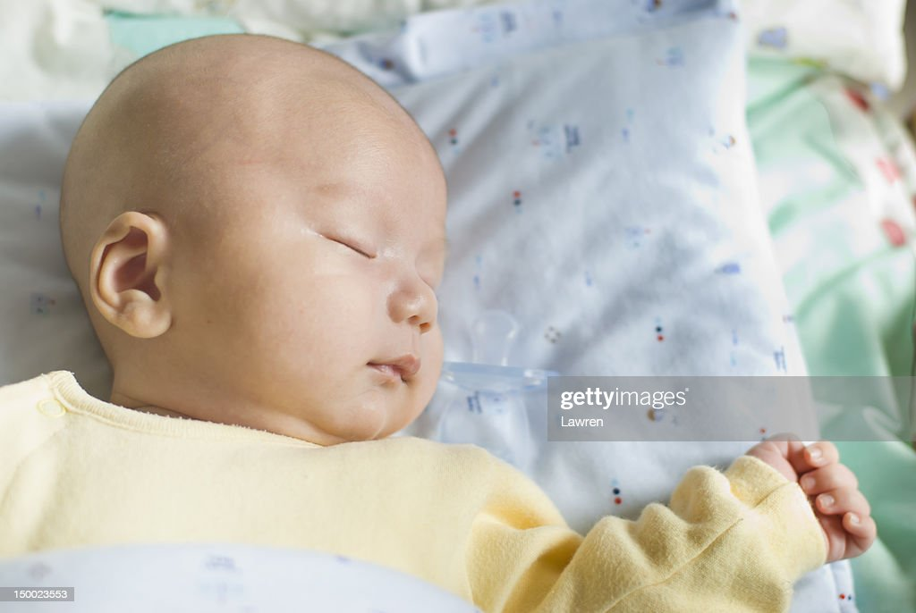 Serene infant is sleeping deeply. : Stock Photo