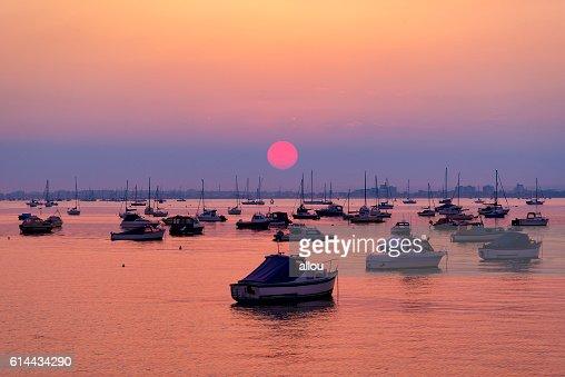 Serene sunset over boats at Sandbanks, Poole, Dorset near Bournemouth : Stock Photo