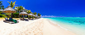 white sandy beach and turquoise sea of Mauritius island