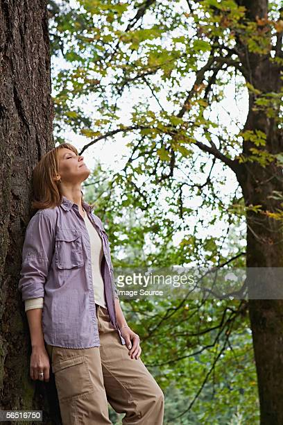 Serene woman in a forest