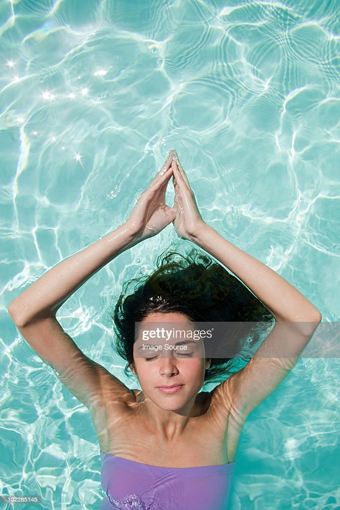 Serene woman in swimming pool : Stock Photo