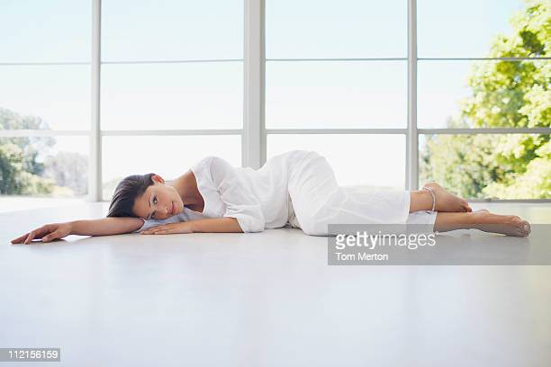 Serene woman laying on floor