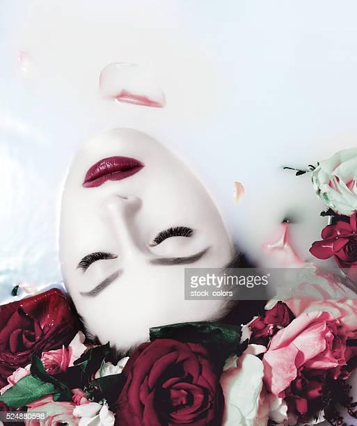 serene woman relaxing in milk