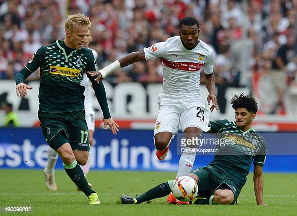 Serey Die of Stuttgart is challenged by Oscar Wendt of Borussia Moenchengladbach and Mahmoud Dahoud of Borussia Moenchengladbach during the...