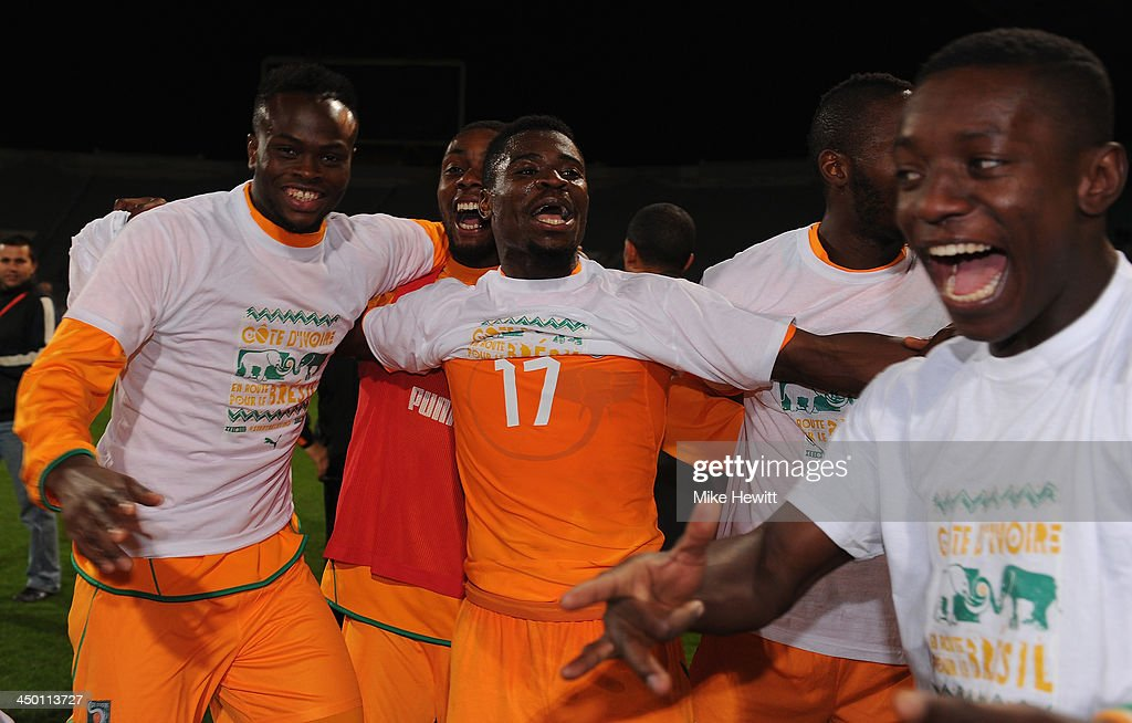 <a gi-track='captionPersonalityLinkClicked' href=/galleries/search?phrase=Serge+Aurier&family=editorial&specificpeople=6716046 ng-click='$event.stopPropagation()'>Serge Aurier</a> of Ivory Coast (17) celebrates qualification with team mates after the FIFA 2014 World Cup Qualifier Play-off Second Leg between Senegal and Ivory Coast at Stade Mohammed V on November 16, 2013 in Casablanca, Morocco.