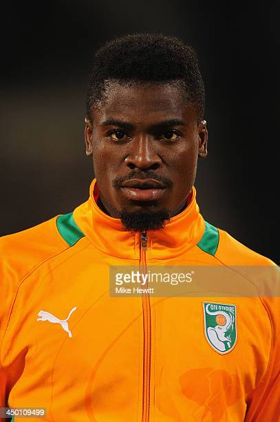 Serge Aurier of Ivory Coast lines up for the National Anthem ahead of the FIFA 2014 World Cup Qualifier Playoff Second Leg between Senegal and Ivory...
