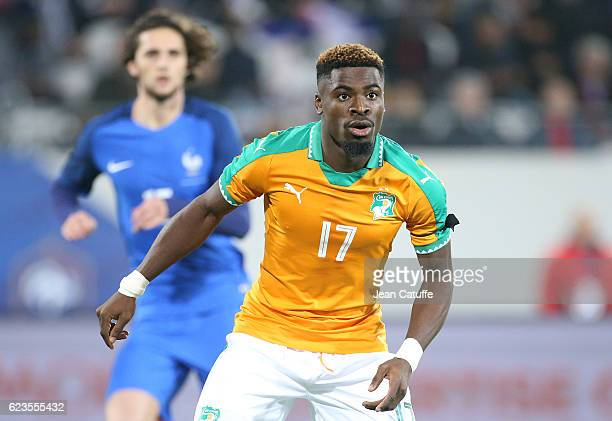 Serge Aurier of Ivory Coast looks on during the international friendly match between France and Ivory Coast at Stade Felix Bollaert Delelis on...