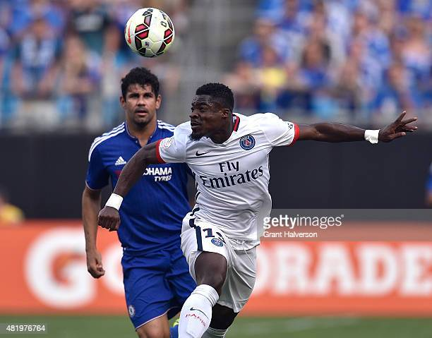 Serge Aurier of Paris SaintGermain beats Diego Costa of Chelsea to a loose ball during their Internationl Champions Cup match at Bank of America...