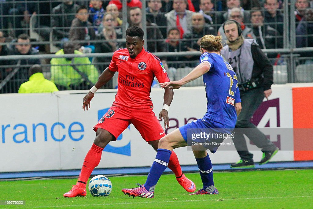 <a gi-track='captionPersonalityLinkClicked' href=/galleries/search?phrase=Serge+Aurier&family=editorial&specificpeople=6716046 ng-click='$event.stopPropagation()'>Serge Aurier</a> #19 of Paris Saint-Germain FC controls the ball against <a gi-track='captionPersonalityLinkClicked' href=/galleries/search?phrase=Guillaume+Gillet&family=editorial&specificpeople=4542498 ng-click='$event.stopPropagation()'>Guillaume Gillet</a> #27 of SC Bastia during the French League Cup Final (Coupe de la Ligue) game between SC Bastia and Paris Saint-Germain FC at Stade de France on April 11, 2015 in Saint Denis near Paris, France.