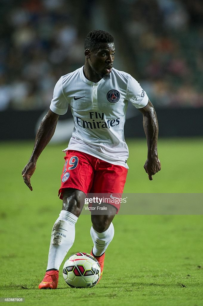 <a gi-track='captionPersonalityLinkClicked' href=/galleries/search?phrase=Serge+Aurier&family=editorial&specificpeople=6716046 ng-click='$event.stopPropagation()'>Serge Aurier</a> of Paris Saint-Germain in action during the friendly match between Kitchee and Paris Saint-Germain at Hong Kong Stadium on July 29, 2014 in Hong Kong, Hong Kong.