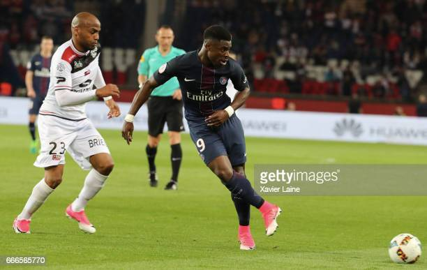 Serge Aurier of Paris SaintGermain in action with Jimmy Briand of EA Guingamp during the French Ligue 1 match between Paris Saint Germain and EA...