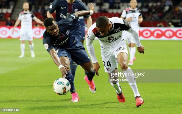 Serge Aurier of Paris SaintGermain in action with Marcus Coco of EA Guingamp during the French Ligue 1 match between Paris Saint Germain and EA...