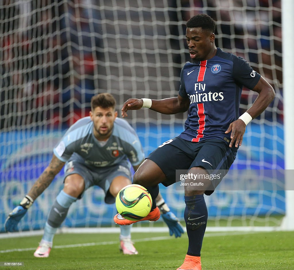 <a gi-track='captionPersonalityLinkClicked' href=/galleries/search?phrase=Serge+Aurier&family=editorial&specificpeople=6716046 ng-click='$event.stopPropagation()'>Serge Aurier</a> of PSG and goalkeeper of Rennes <a gi-track='captionPersonalityLinkClicked' href=/galleries/search?phrase=Benoit+Costil&family=editorial&specificpeople=4839467 ng-click='$event.stopPropagation()'>Benoit Costil</a> in action during the French Ligue 1 match between Paris Saint-Germain (PSG) and Stade Rennais FC at Parc des Princes stadium on April 29, 2016 in Paris, France.